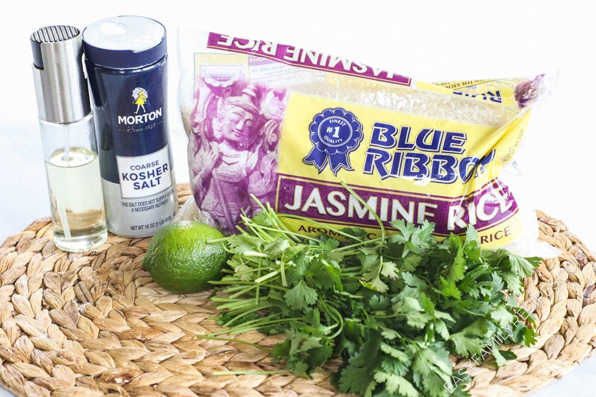 Ingredients to make chipotle cilantro lime rice including jasmine rice, fresh cilantro, lime juice, salt, oil