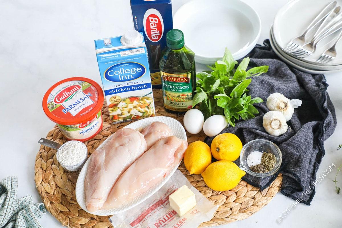 Ingredients for lemon basil chicken including chicken breast, parmesan, butter, chicken broth, fresh basil, lemon and garlic