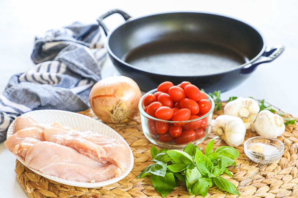 Ingredients for Chicken Pomodoro including chicken breast, tomatoes, basil, onion, and garlic