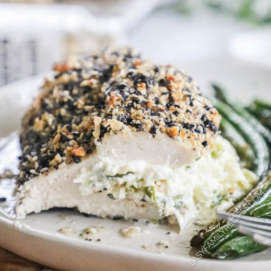 Chicken coated with Everything Bagel seasoning stuffed with garlic cream cheese and baked