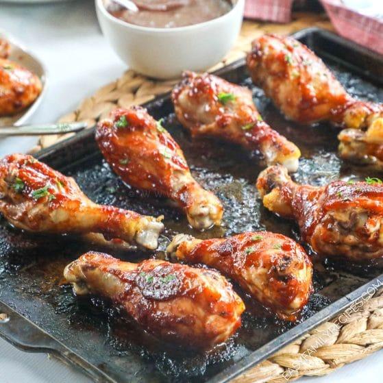 Oven Baked BBQ Chicken Drumsticks on baking sheet