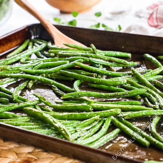 Green Beans seasoned with salt and pepper and baked in the oven on a baking sheet