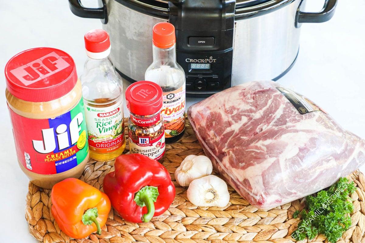 Ingredients to make crockpot Thai Pork- Pork shoulder, red peppers, garlic peanut butter, soy sauce, rice wine vinegar