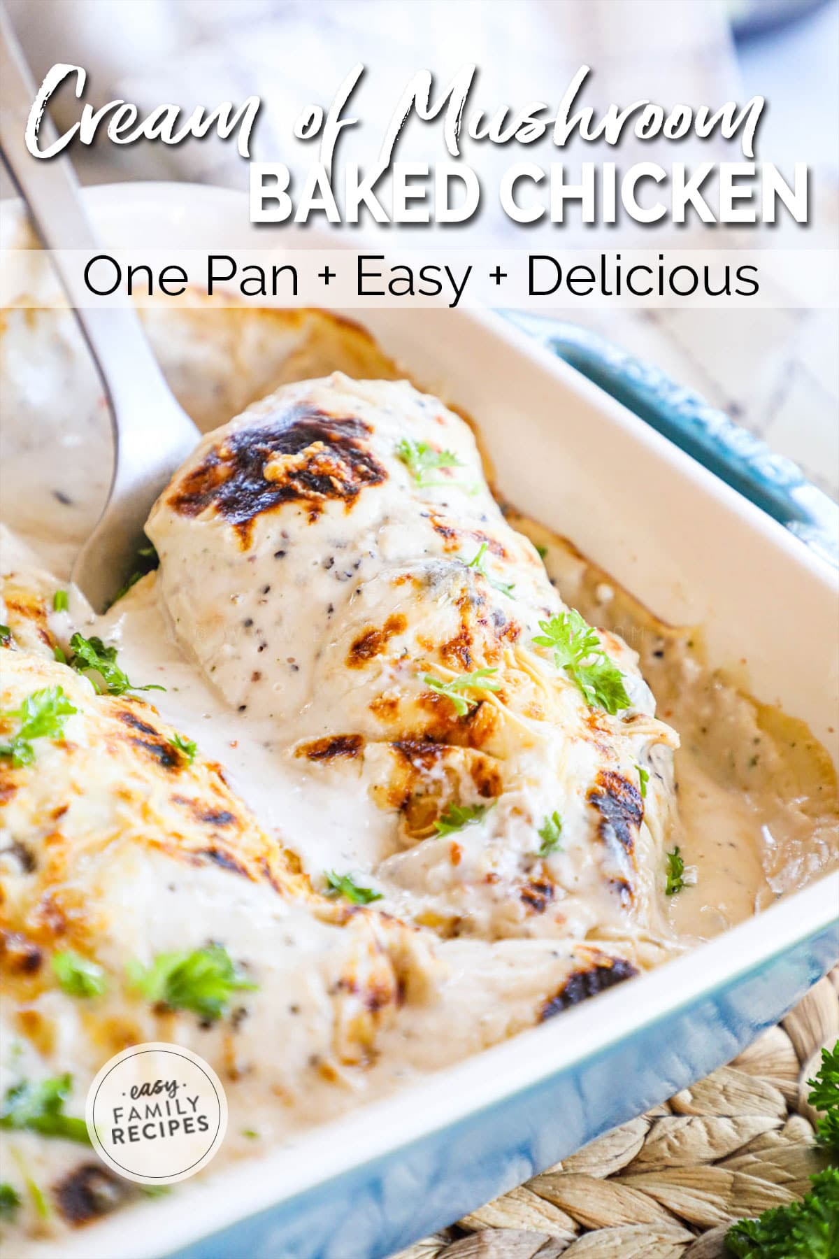 Lifting baked chicken breast smothered in cream of mushroom soup to serve