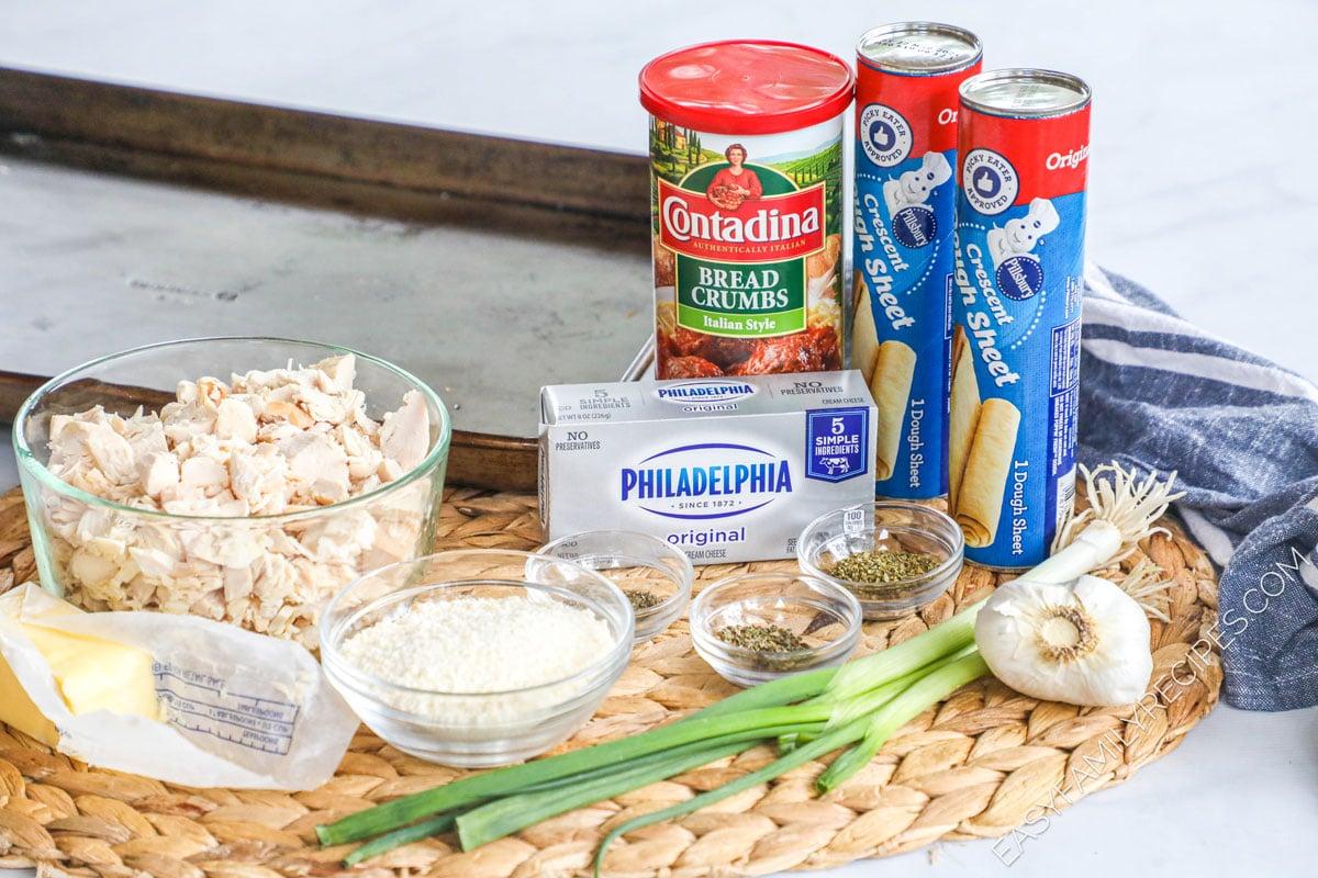 Garlic Herb Chicken Pillows recipe ingredients including pillsbury crescent rolls cream cheese, rotisserie chicken, garlic, herbs, bread crumbs, parmesan cheese, butter