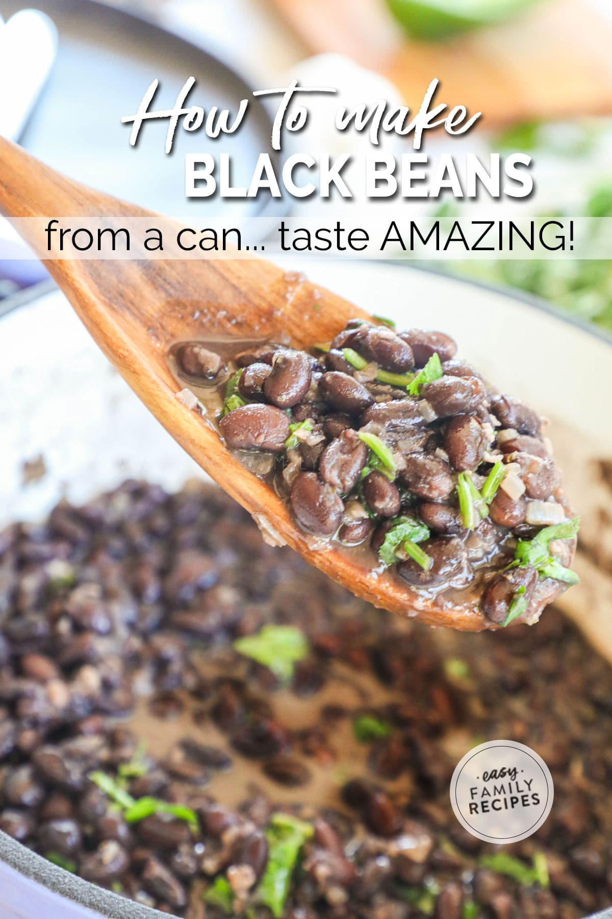 Spoon lifting canned black beans seasoned with cilantro from pot