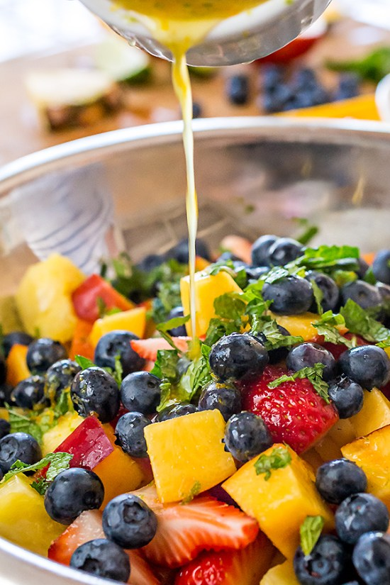 There's nothing quite like indulging in fresh fruit in the summertime, and this gussied up Rainbow Fruit Salad with Citrus-Honey Dressing and Fresh Mint is a colorful and delicious way to enjoy it!