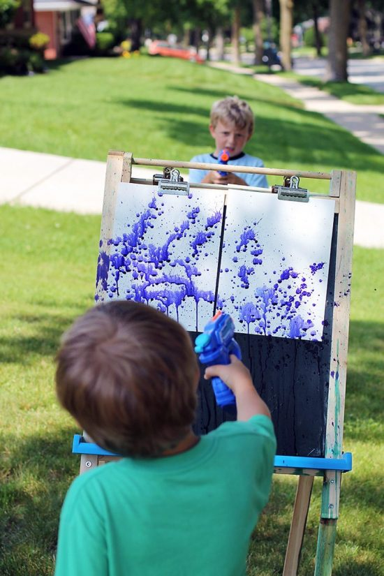 Squirt gun painting is athrilling summer art experience for kids and theultimate boredom buster!