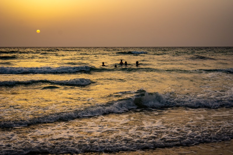 Wild beach camping in Oman - sunset swim