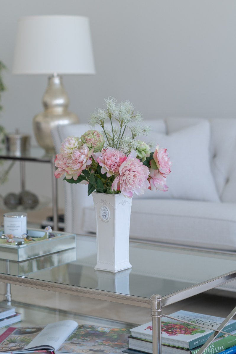 Decorating home for spring with artificial flower arrangements