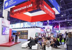 Matthew Stream speaking and the Innovation Lab Booth at G2E