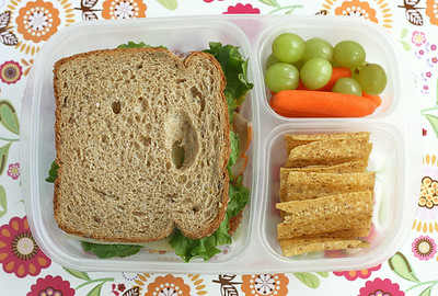 Sandwich (peppered turkey, havarti cheese, lettuce and mustard on whole grain bread), baby carrots and green grapes and SunChips. Photo credit: Another Lunch  http://bit.ly/aJst4n
