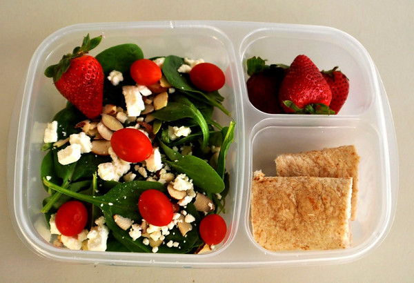 Spinach salad with feta cheese, almonds, grape tomatoes.  Strawberries, turkey and cheese rolled in a whole wheat flour tortilla. Thanks to Amanda of lunchbox limbo  http://bit.ly/cSYUhm for this one!