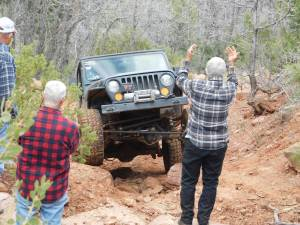 Needing a little help. This is just one of our many trails that require experience and assistance from a spotter. It is better to use the spotter than damage your Jeep and require the winch line. Photographer: Garah Monnich