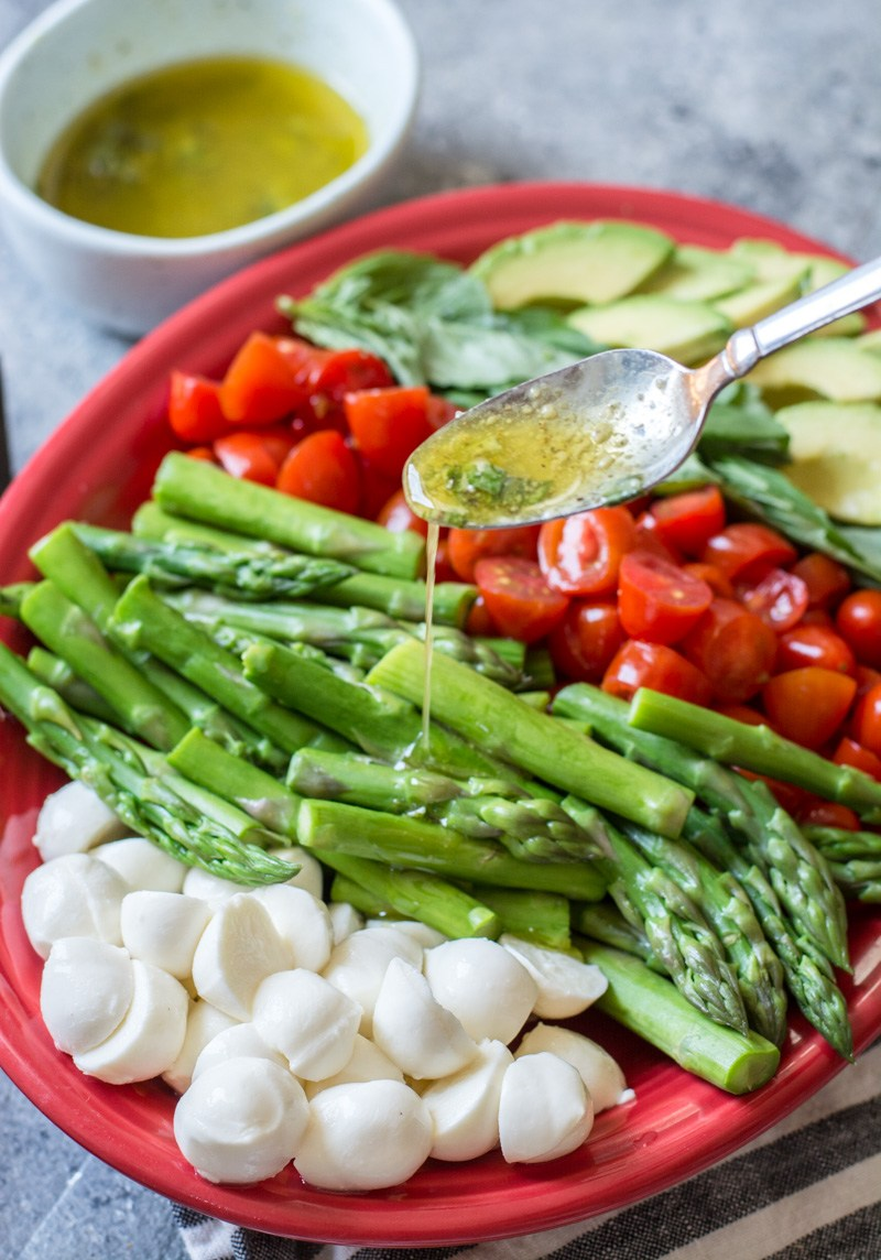 This Keto Asparagus, Tomato and Avocado Salad is drizzled in a creamy lemon vinaigrette! The perfect low carb summer salad!