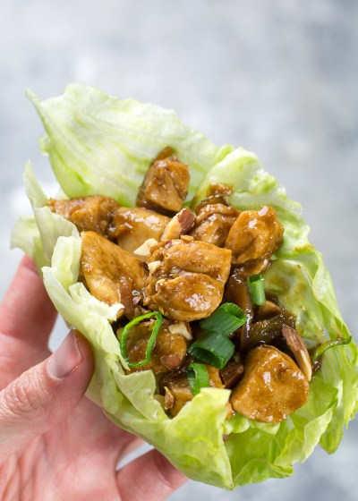 Sesame Chicken Lettuce Wraps are only about 4 net carbs per serving! This savory sesame chicken is wrapped in crisp lettuce and topped with crunchy nuts and fresh green onions!