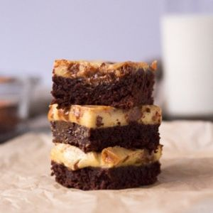 gluten free cheesecake brownies with dulce de leche and milk