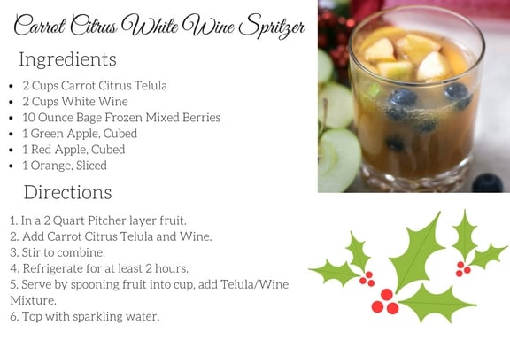 Carrot Citrus White Wine Spritzer is the perfect holiday drink, Full of fruit with the perfect combo of wine and juice. Top with sparkling water!