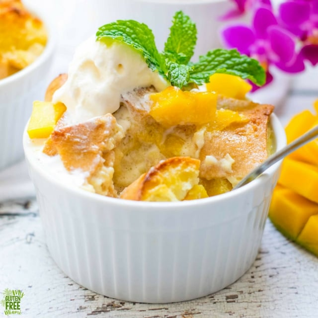 partially eaten gluten free mango bread pudding in ramekin