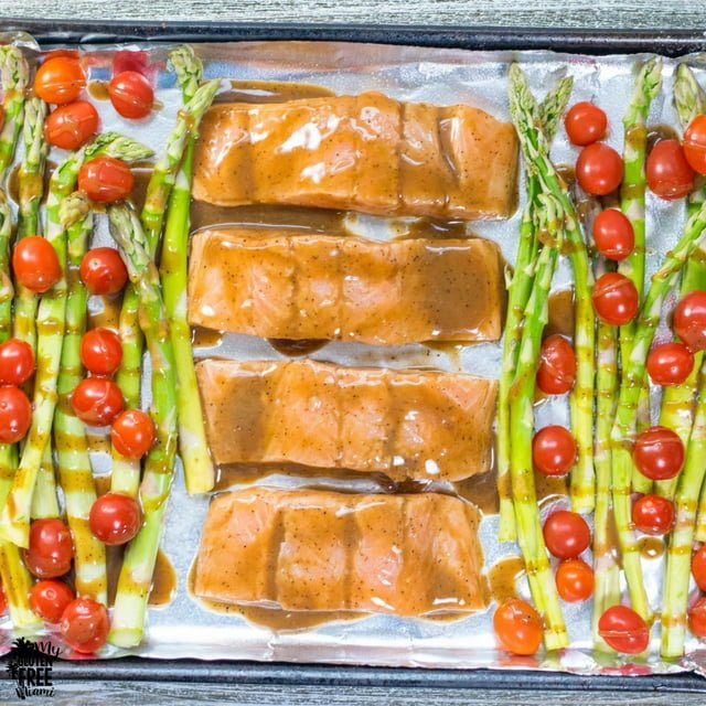 pan of salmon and asparagus with balsamic glaze