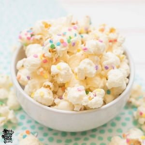 white chocolate popcorn with sprinkles in a bowl