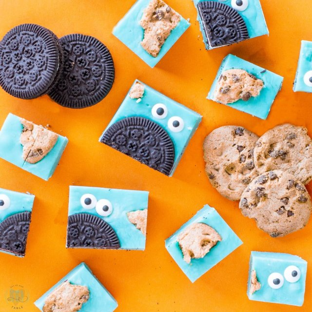 Cookies and gluten free cookie monster fudge on orange backdrop.