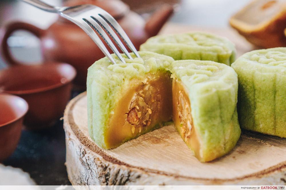 Inside of green snowskin mooncake; lotus paste filling