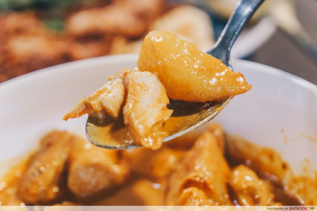 Emmanuel Peranakan Cuisine - Spoonful of curry chicken and potato