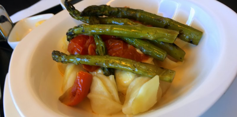 Etihad Business Class lunch - Orecchiette pasta with fresh cherry tomato ragout and melted bocconcini char grilled asparagus.
