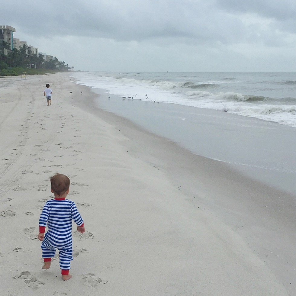 The boys at the beach during the tropical storm