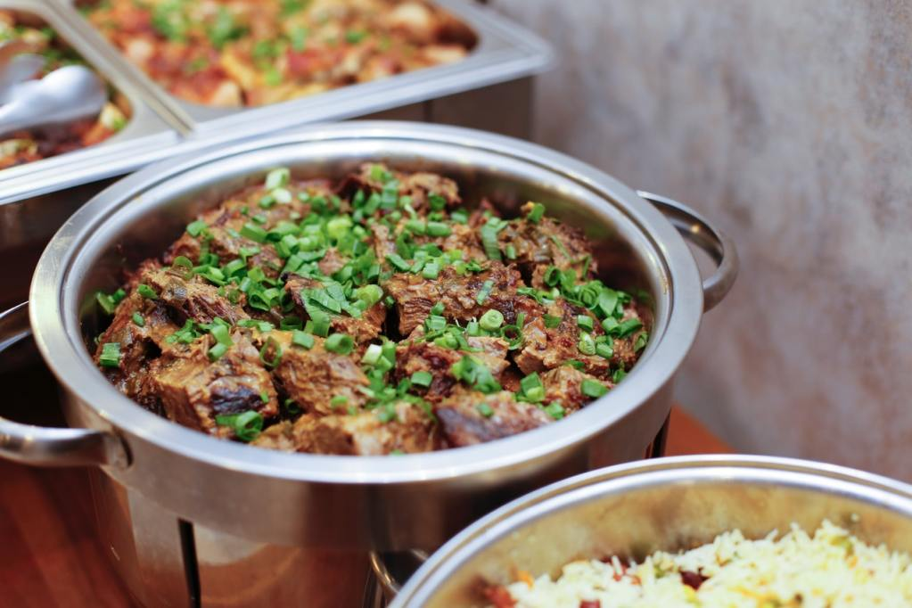 Restaurant family meal in silver pots to improve restaurant worker wellness