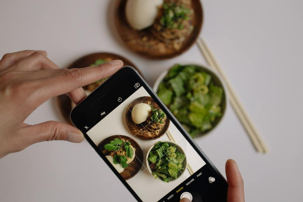 iPhone taking photo of Asian food for Instagram