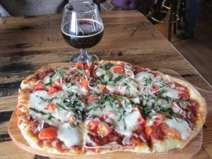 Margherita Flatbread Pizza: Crushed-tomato sauce, provolone, buffalo mozzarella, fresh basil, tomato, with a Grand Cru from Sanitas Brewing