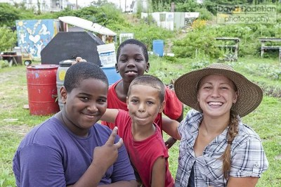 Emily Jodka, New Urban Farmers co-founder, with some of the neighborhood children