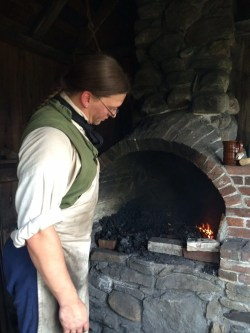 Casey Duckett, Assistant Director, operating the the Blacksmith Shop