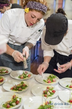 Chefs Jordan Goldsmith and Ashley Scungio Vanasse preparing the salad course at the 2015 Festival Dinner by Dames. Photo by Stacey Doyle Photography