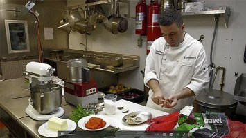 Hemenway's Chef Max Peterson preparing Clams Casino on Bizarre Foods: Delicious Destinations