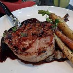 Sous vide simmered, grilled pork chop with apple, fig and port reduction.  | Photo by Steve Coomes