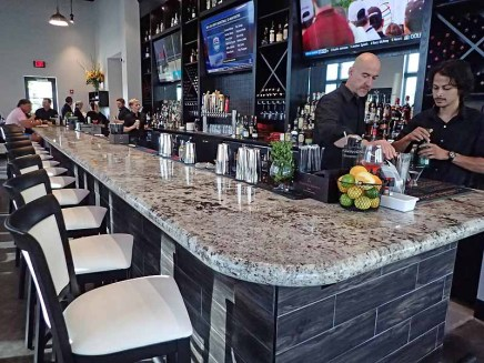 The long and well-stocked bar at The 502.   Photo by Steve Coomes