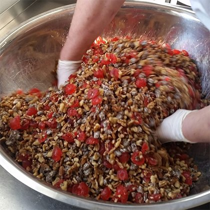 Nuts and Fruit Mixed by Hand for Gourmet Fruitcake