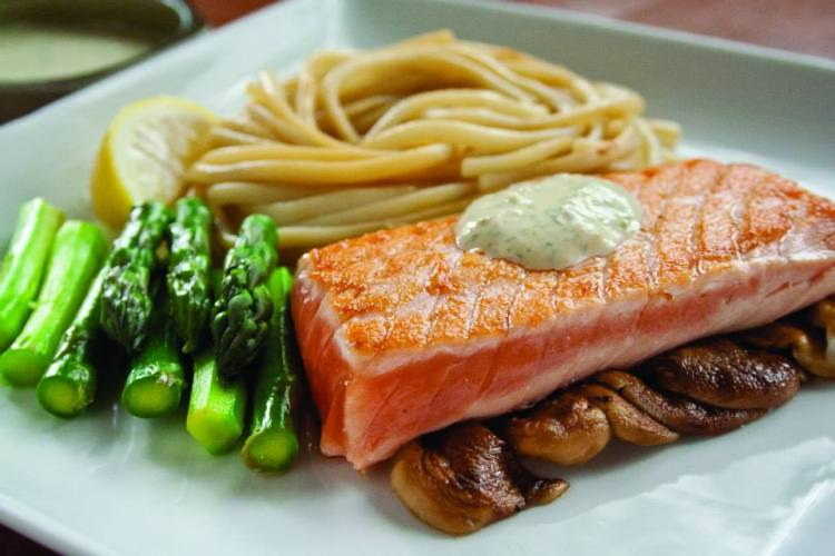Delicious Hibachi salmon with noodles and asparagus