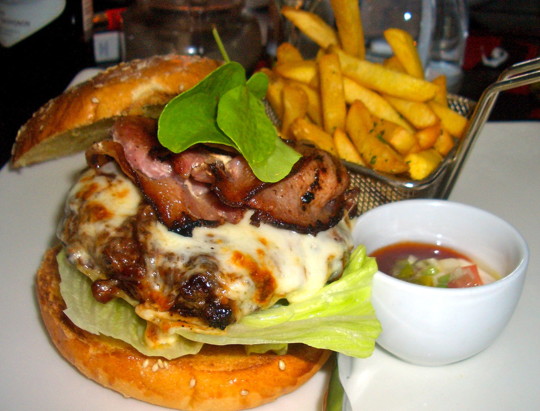 an amazing cheese and bacon burger at firemans arms aqua shard subdued lighting
