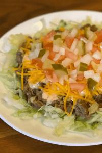 Big Mac salad on a white plate