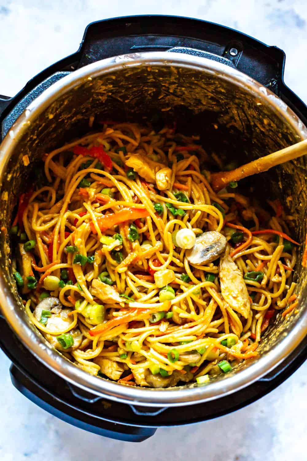 instant pot lo mein with chicken eating instantly