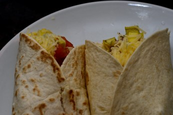 Fold the bottom up, then fold the sides over to make an open buritto