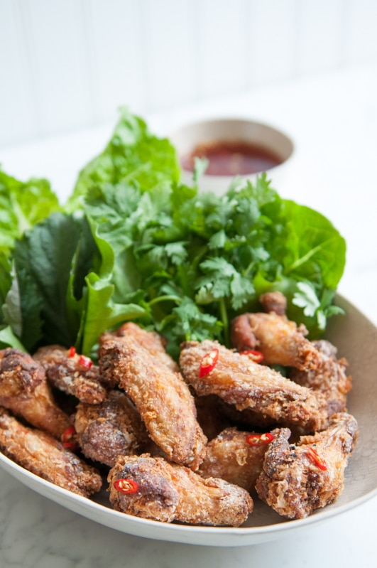 crispy chicken wings with fish sauce with sliced chillies