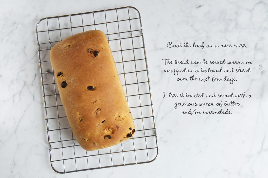 Step by step photos for making fruit loaf. Finished and baked fruit loaf on wire rack on marble work surface.