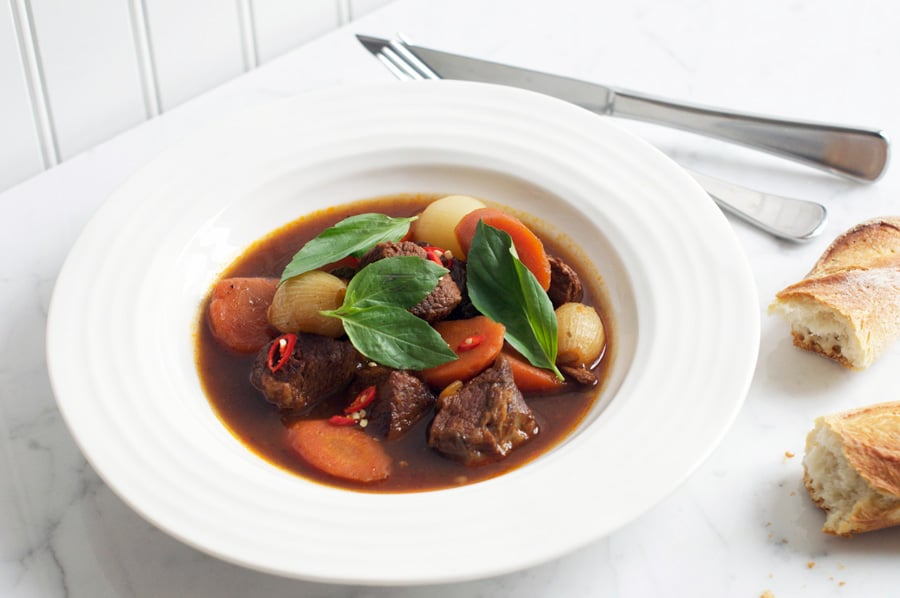 vietnamese beef stew with torn pieces of crusty baguette