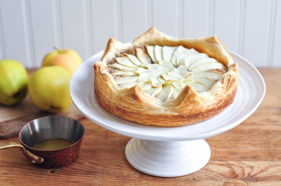 galette des rois with apples on cake stand