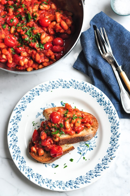 spicy baked beans with blue napkin